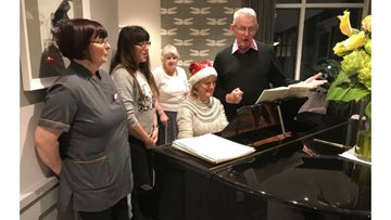Carol singing leaves Residents feeling festive