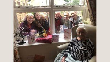 A birthday window visit for Lyndon Hall care home Resident