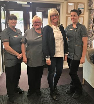 Bar staff raise a glass for local care home Residents