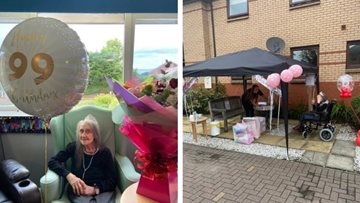 Glasgow care home Resident enjoys socially distanced visit on 99th birthday