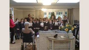 Carol singing at Adelaide House