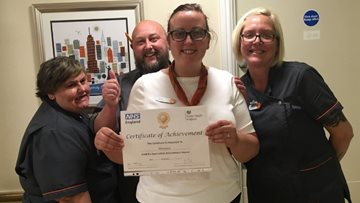 Silverwood care home team celebrates Gold Flu Vaccination Achievement Award