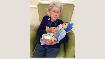 Resident spending time with baby at Rochdale care home