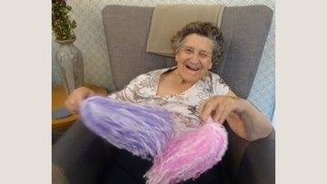 Residents shake their pom-poms at Grimsby care home