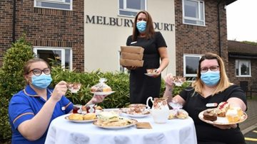 Local house builder brings tea-licious donation to Durham care home