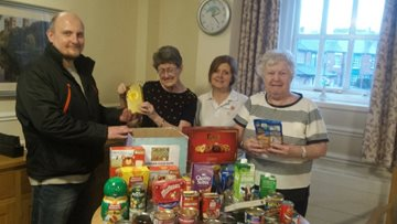 St Margaret's Residents make food bank donation