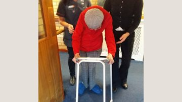 Resident takes first steps in two years at Coventry care home