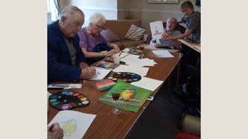 Residents show off their inner artists at Altham Court painting class