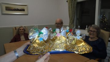 Residents create Christmas decorations for their rooms
