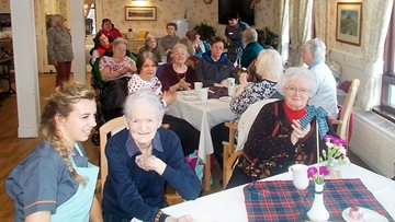 Moss Park Residents celebrate Burns Night with Haggis and Irn Bru