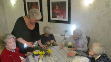 White Rose House enjoys colourful flower arranging afternoon
