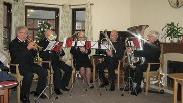 Salvation Army brass band hits the right note at Hinckley care home