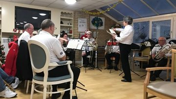 Brass band brings festive cheer to Residents at Bridgend care home