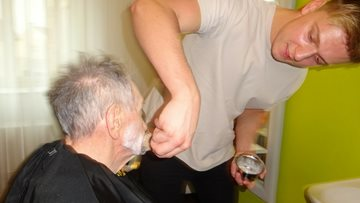 Gentlemen receive hot towel shave at Huddersfield care home