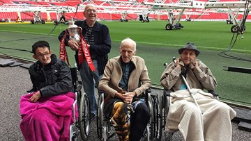 Care home football fans head to the home of English football