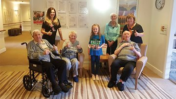 Imogen runs to surprise care home residents