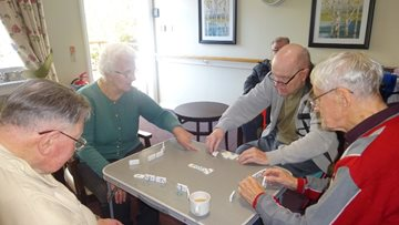 Residents play dominoes at Glenrothes care home