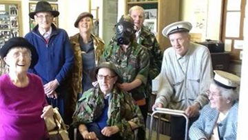 Local care home Residents reminisce about the war years on visit to Swansea Bay museum