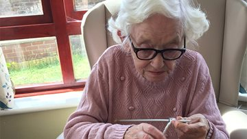 Local Care Home Resident knitting again despite poor eyesight
