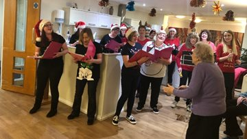 Local female singing group bring festive cheer to Falkirk care home