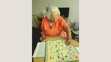 Scrabble board game helps Bath care home Resident build self-confidence