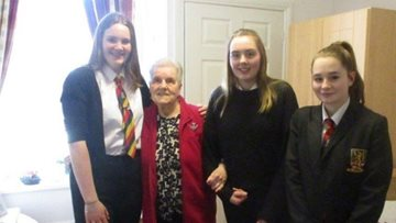 Intergenerational visits delight at Penrith care home