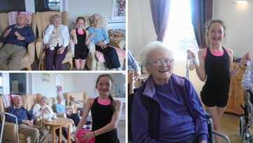Budding gymnast pays Cumbria care home a visit