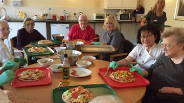 Residents at Plas Cwm Carw celebrate National Pizza Day