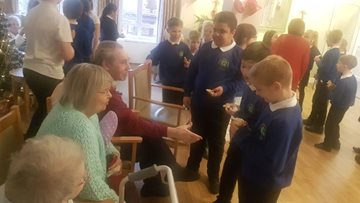 Yoden Primary School join Residents for a Christmas sing along