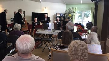 Bolton care home Residents enjoy performance from the Bury Veterans Choir