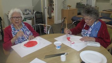 Residents create poppy display for Remembrance Day at Swansea care home