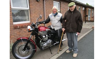 Resident and daughter enjoy a surprise Triumph