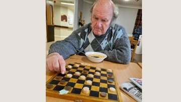 Essex Resident becomes draughts care home champion on his first time playing