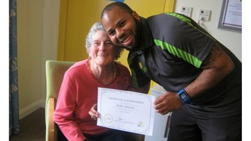 Resident receives Certificate of Achievement for her dedication and motivation