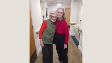 Friends enjoy walk together at Burntwood care home
